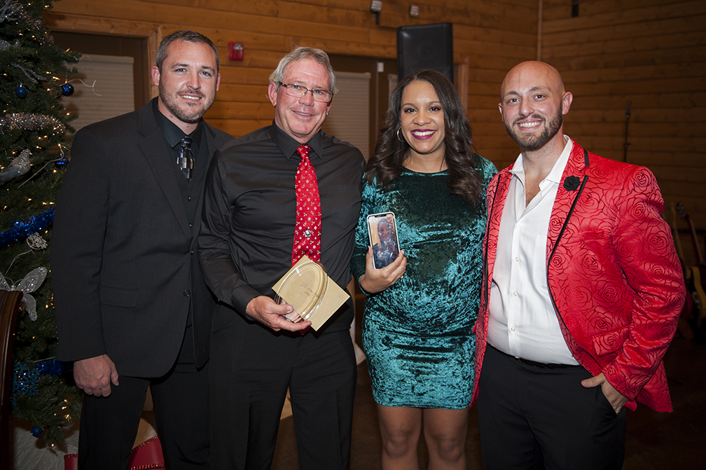 law-enforcement-officer-of-the-year-charlie-taylor-with-coo-tyler-haley-law-enforcement-operations-coordinator-bethany-gill-ceo-jack-byrd